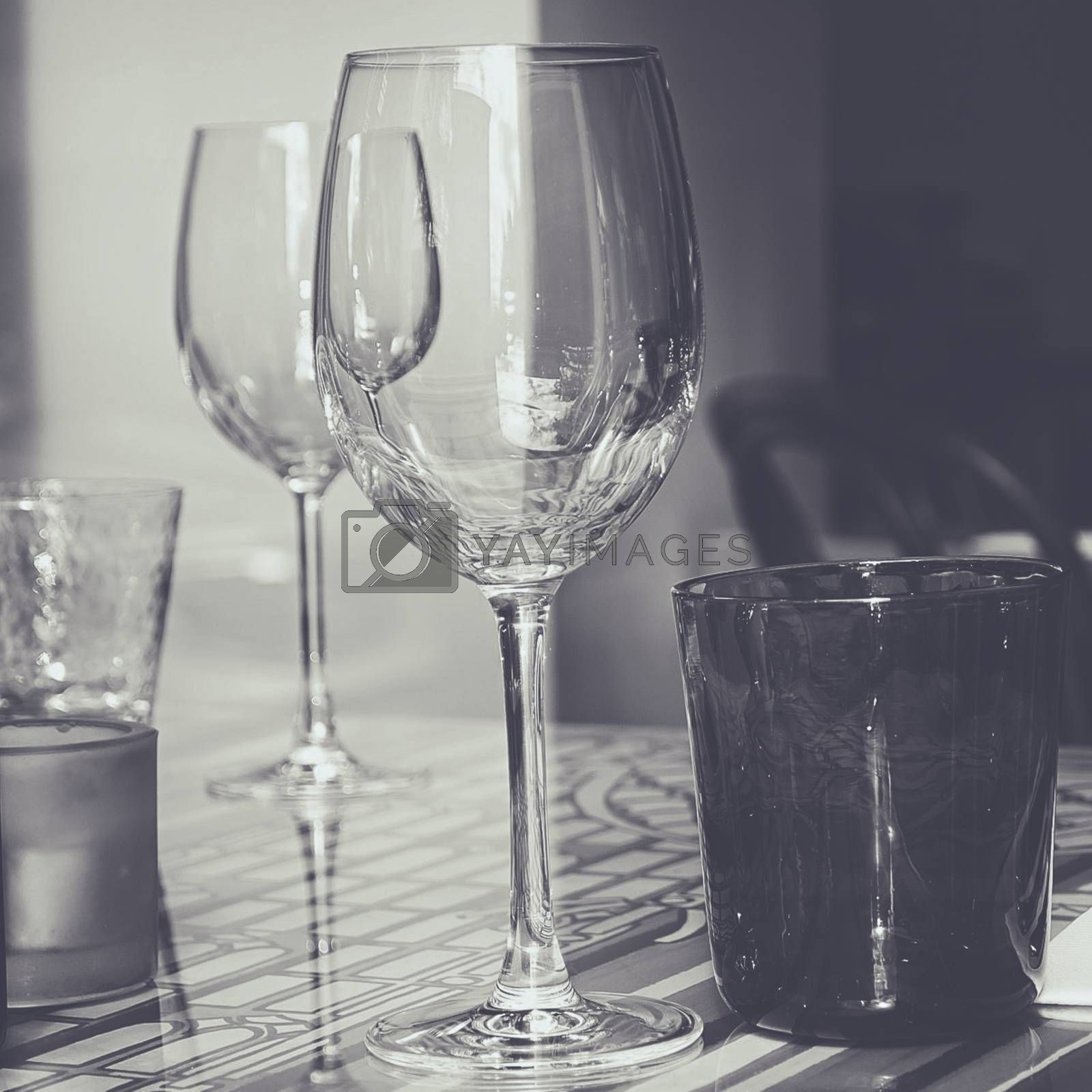 Royalty free image of Crystal glasses on decorated glass table by balage941