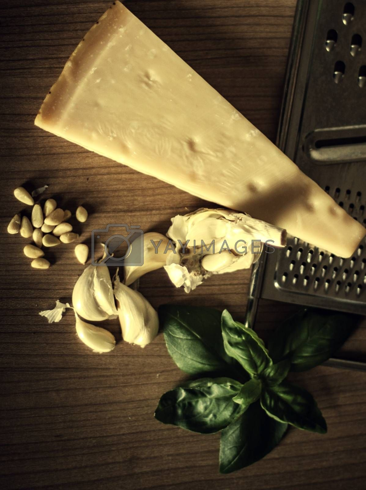 Royalty free image of Parmesan cheese with mint and garlic on the table by balage941