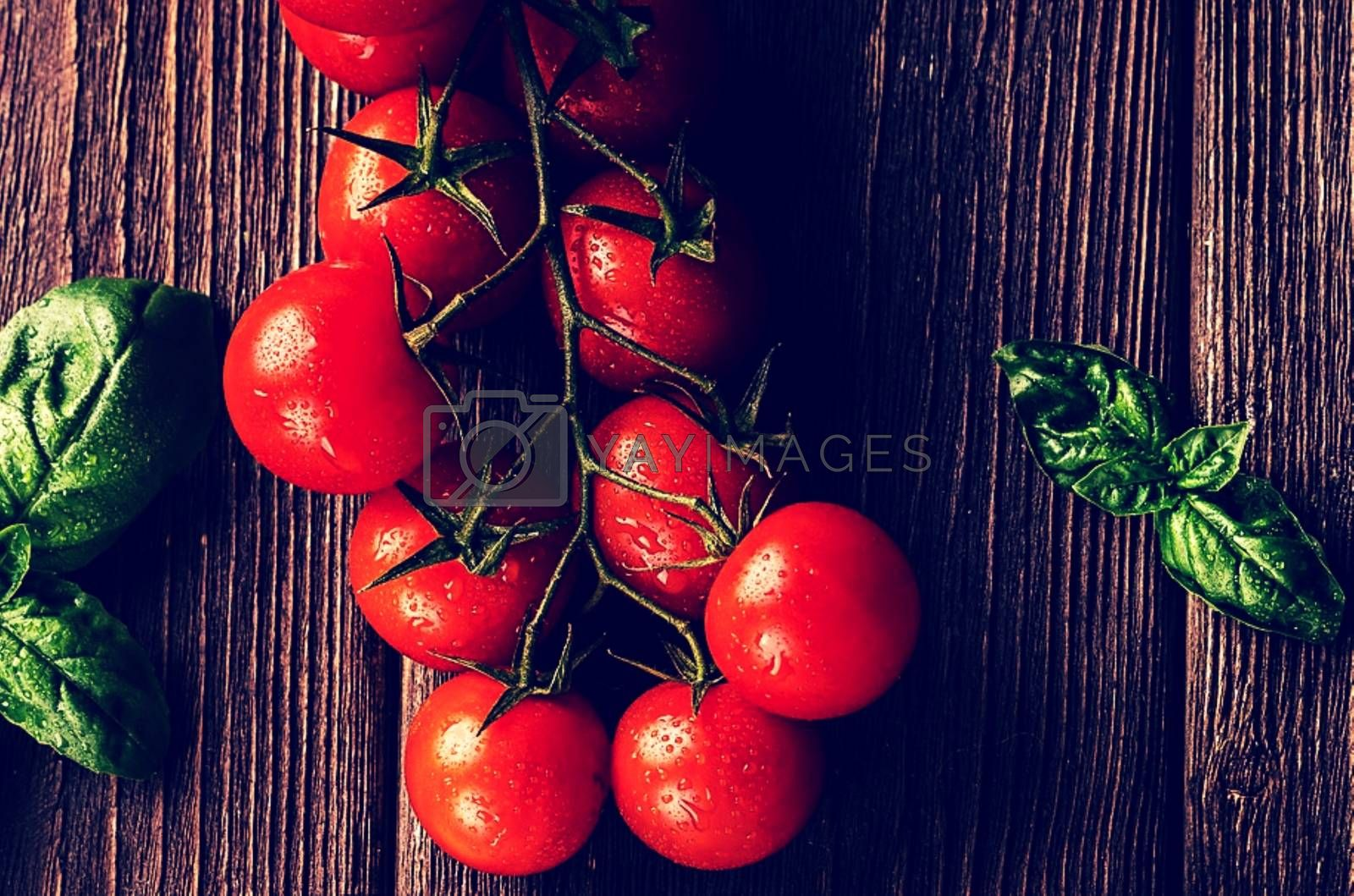 Royalty free image of Some tomatoes sitting on top of a wooden table by balage941