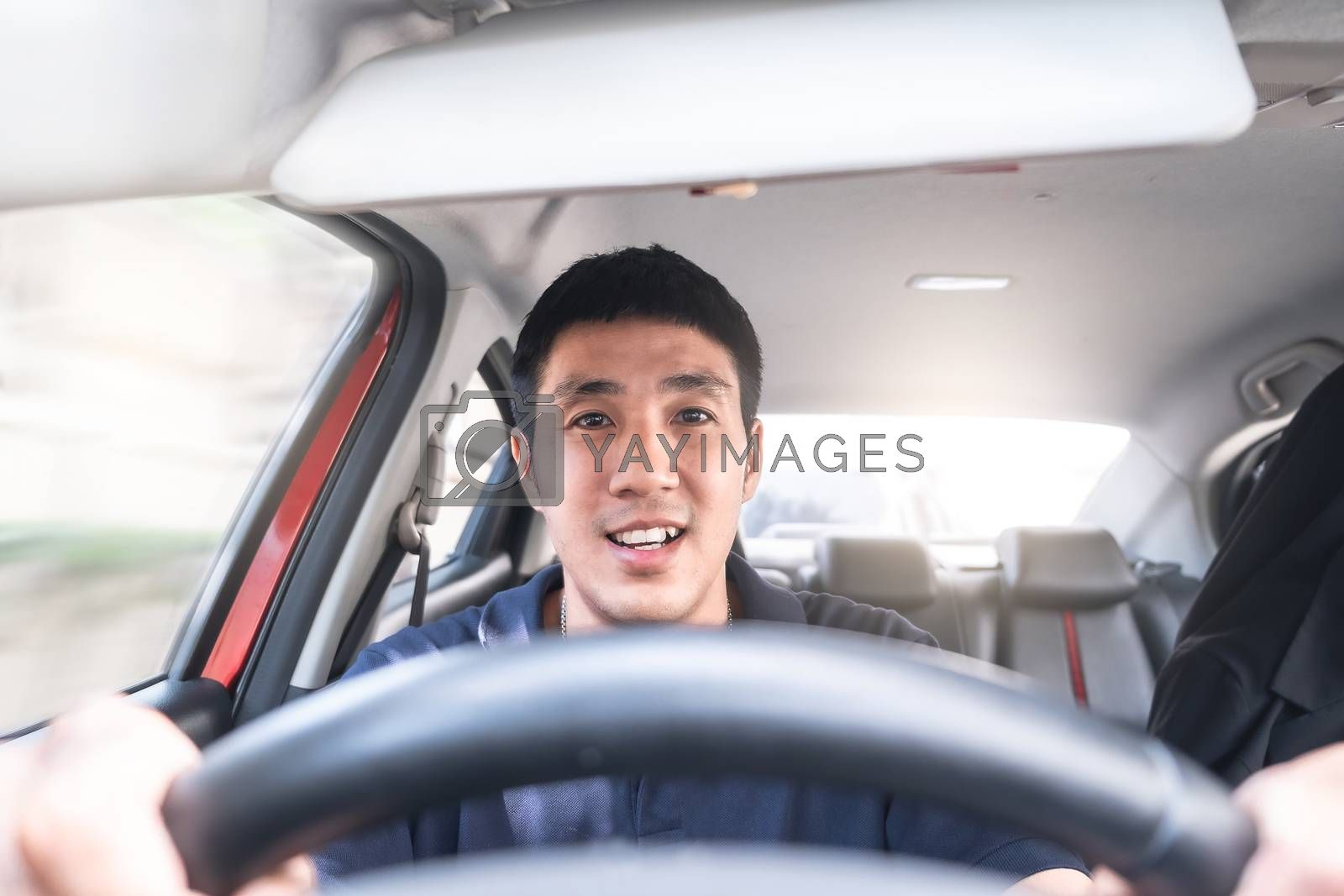 Young Asian man driving car He sometimes smile so happy drive To by oatzpenzstudio