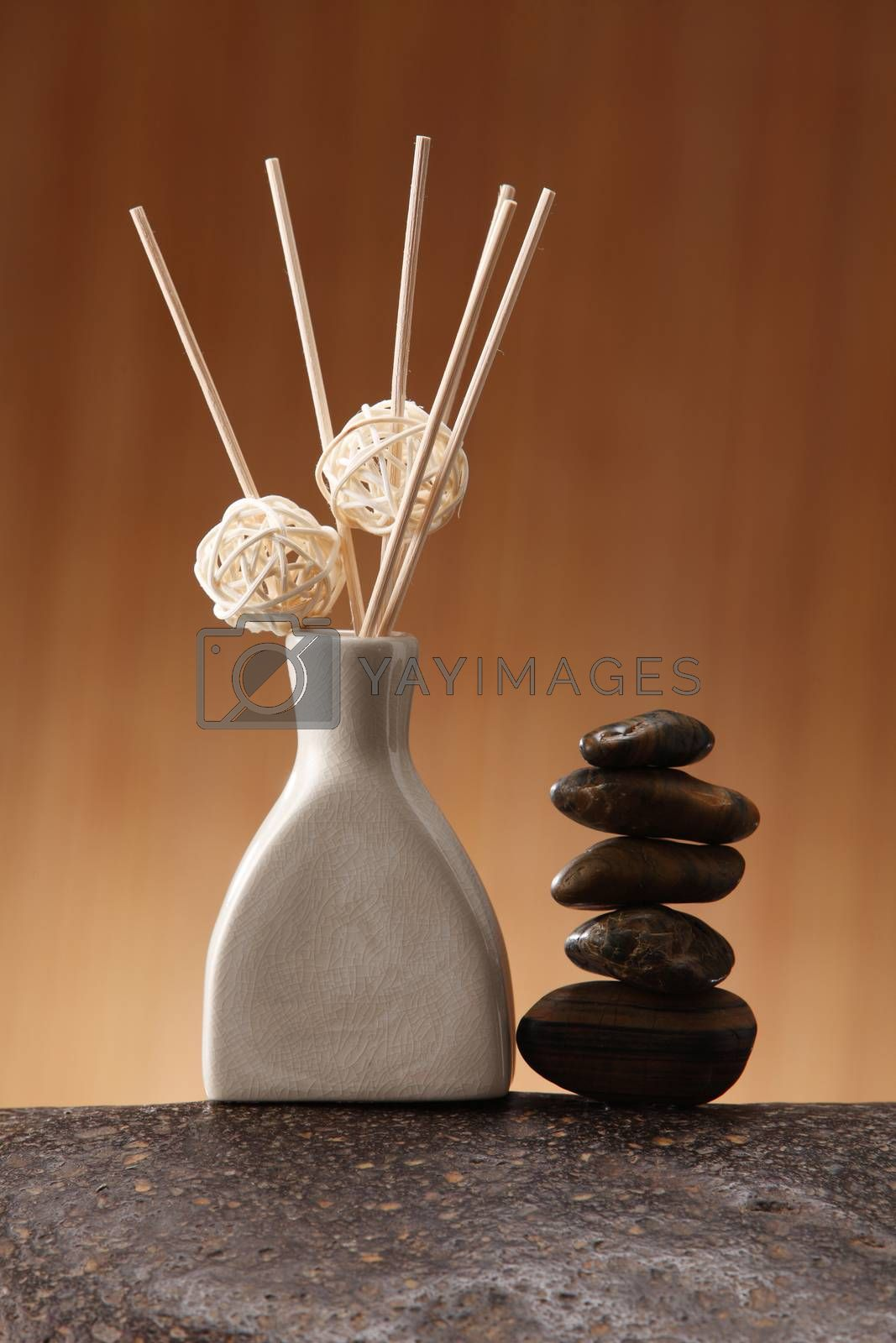Sticks of incense in ceramic jar