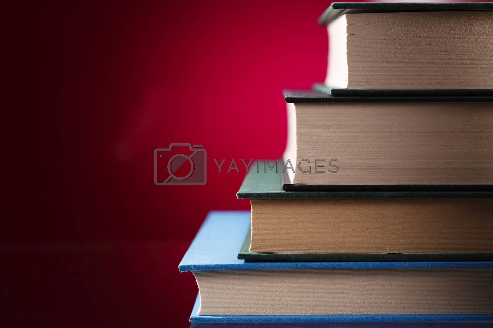 stack of the books on the red background