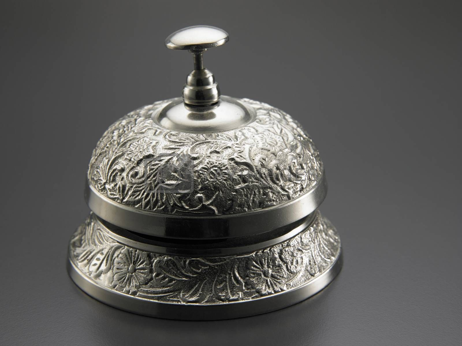 close up of the desk bell on the gray background