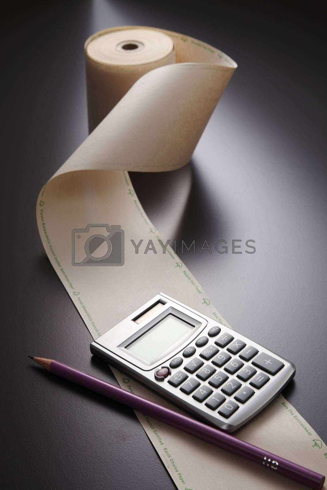 adding machine tape  and calculator