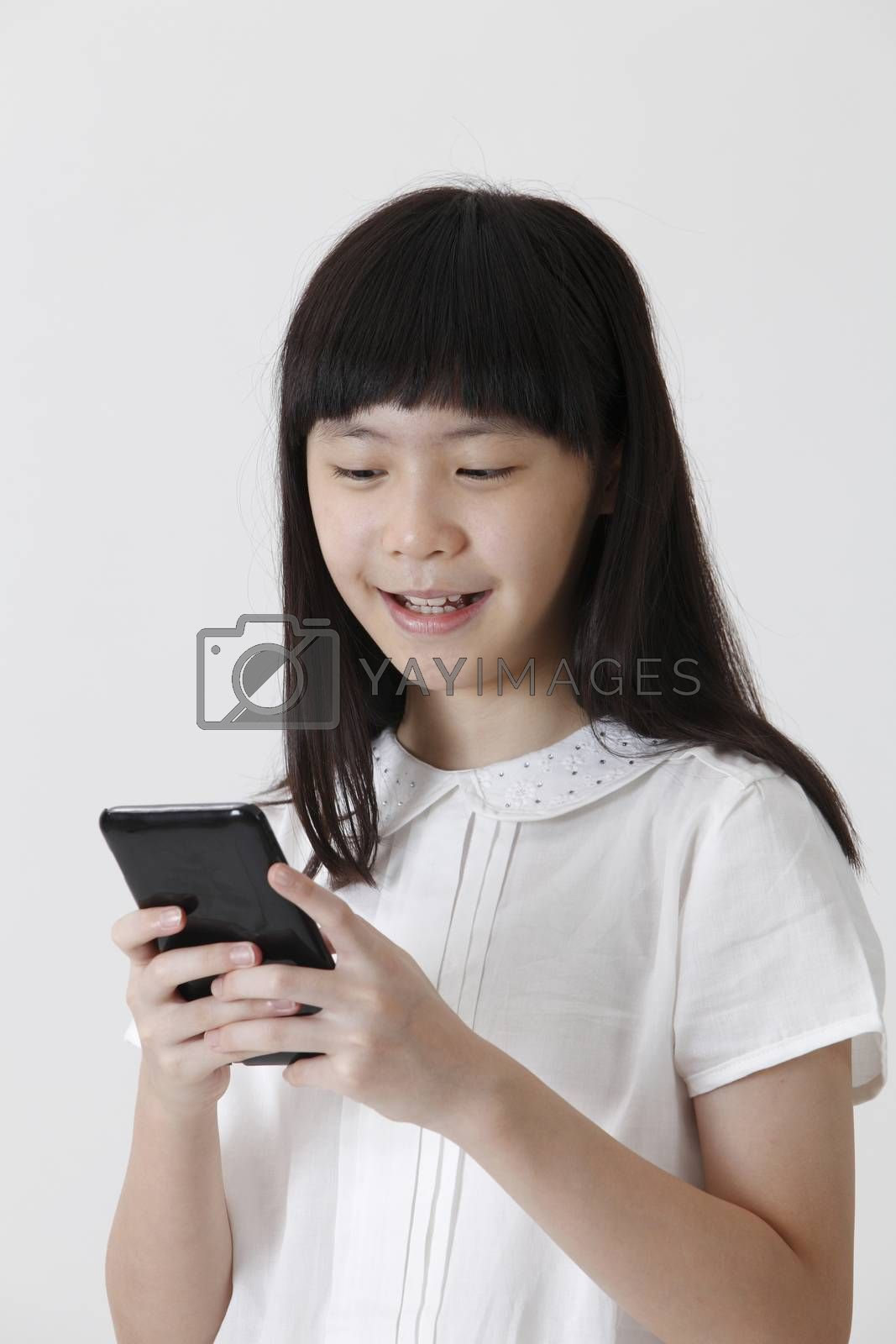 chinese girl sending text message with mobile phone