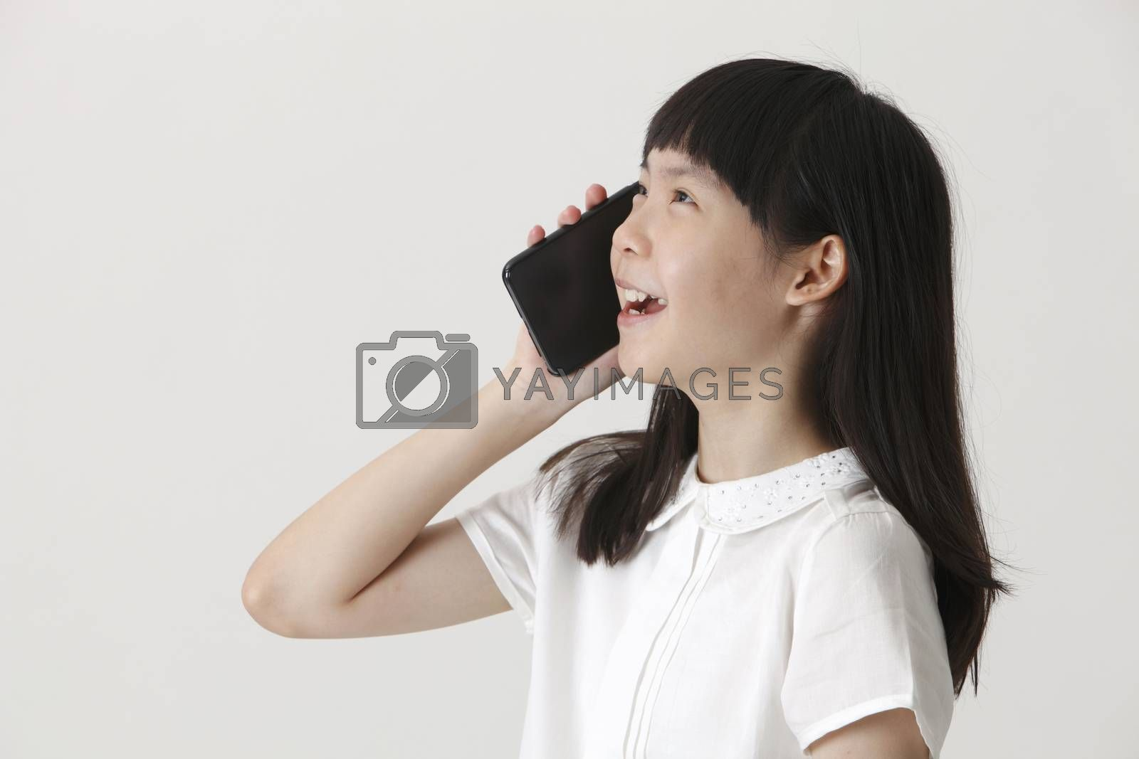 side profile of the chinese girl talking with cellphone
