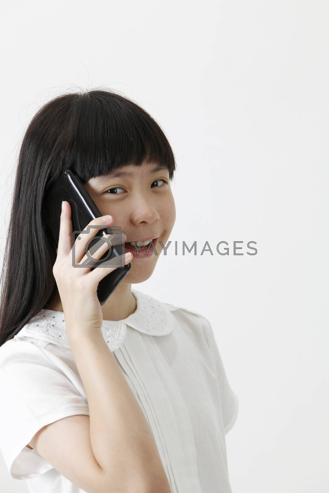 chinese girl talking with cellphone looking at camera