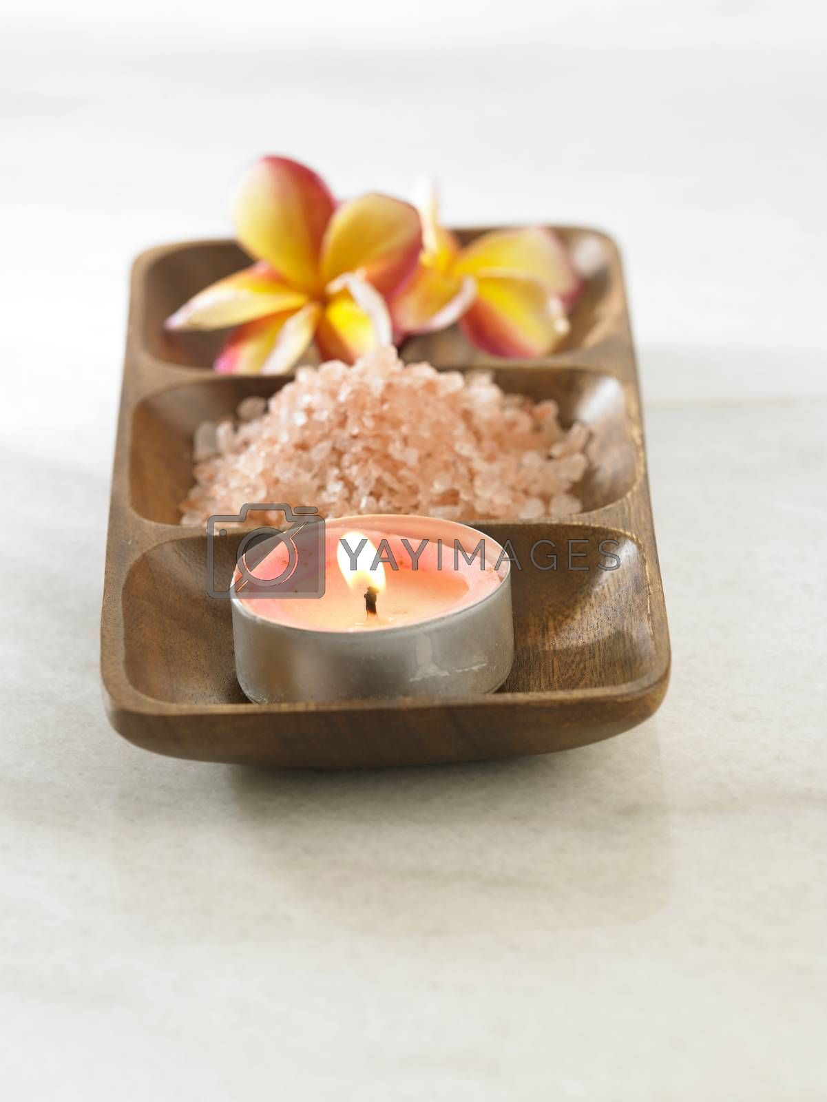 frangipani ,salt and the candle on the wooden tray