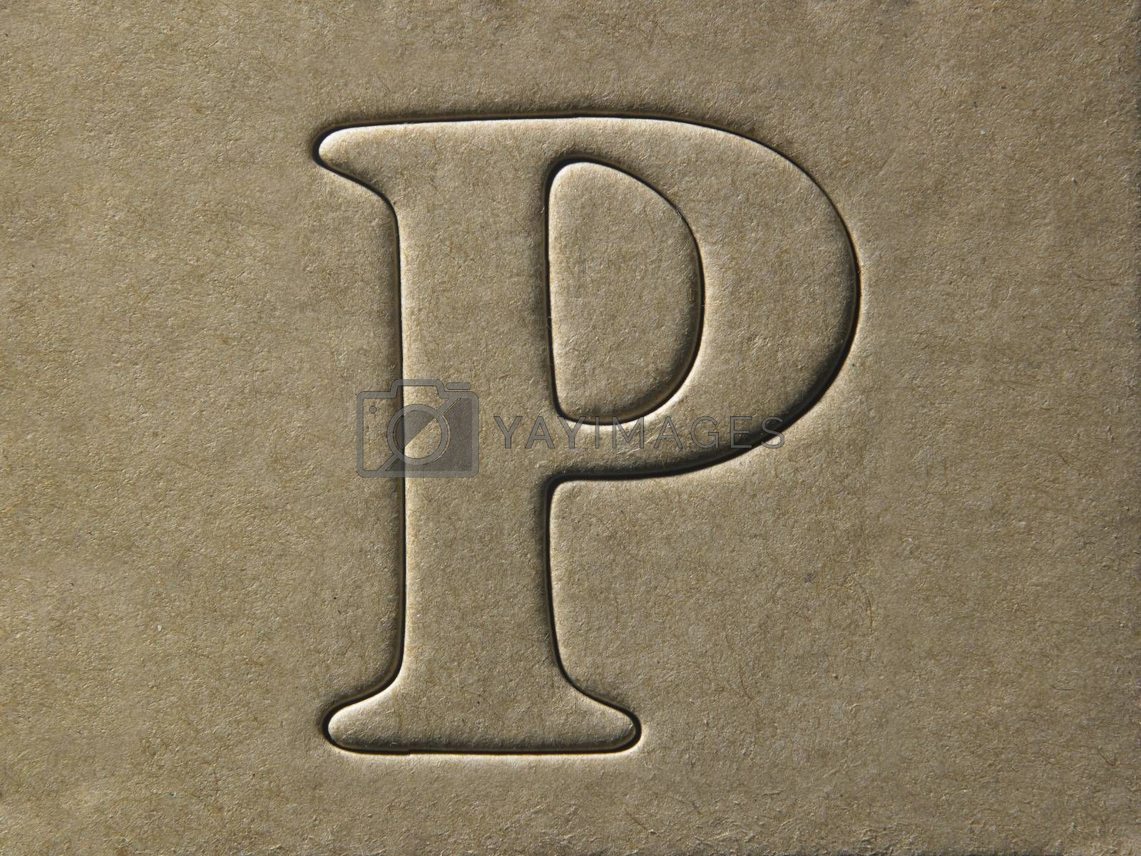 die cut alphabet p on the brown card board