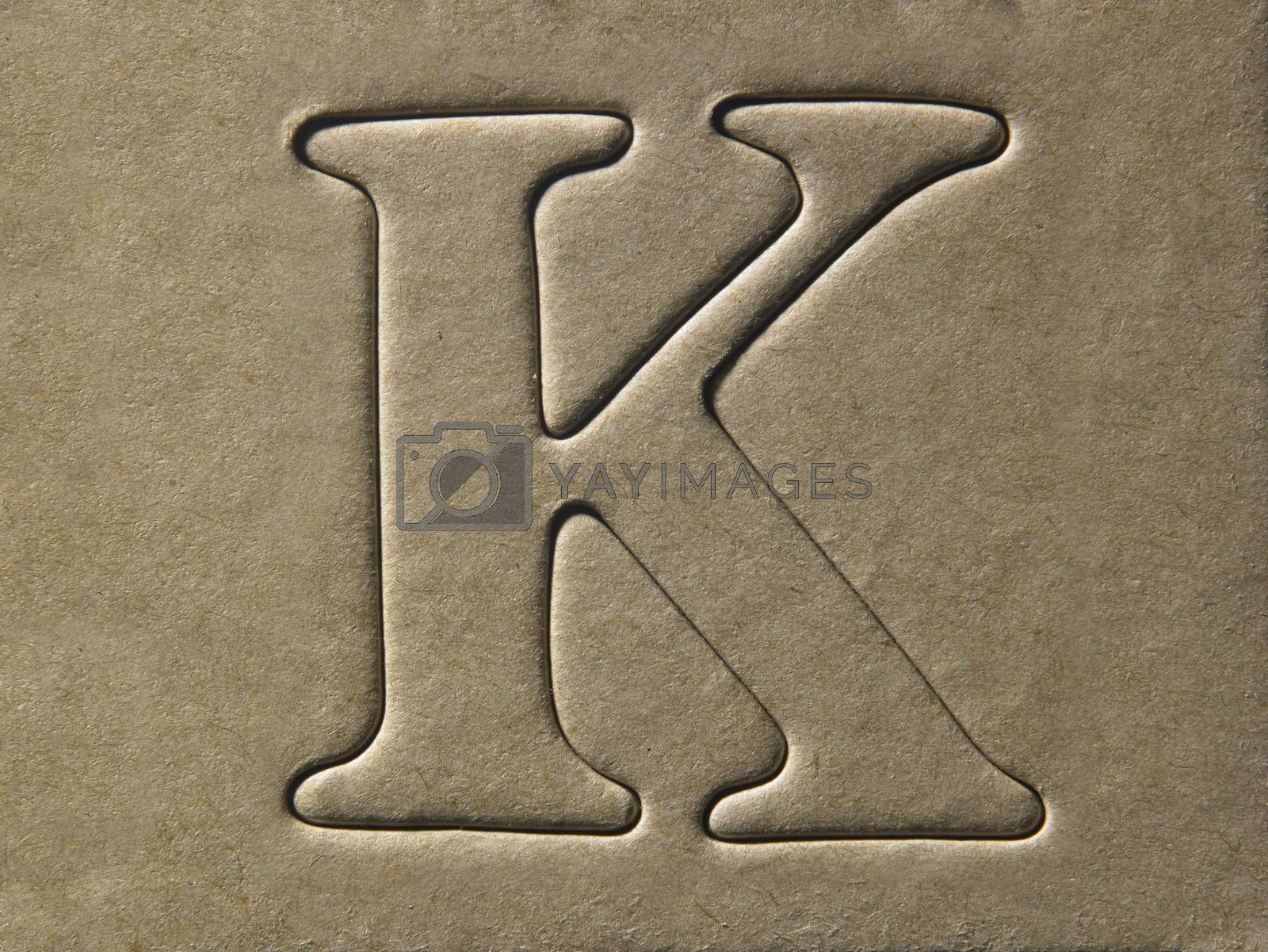 die cut alphabet k on the brown card board