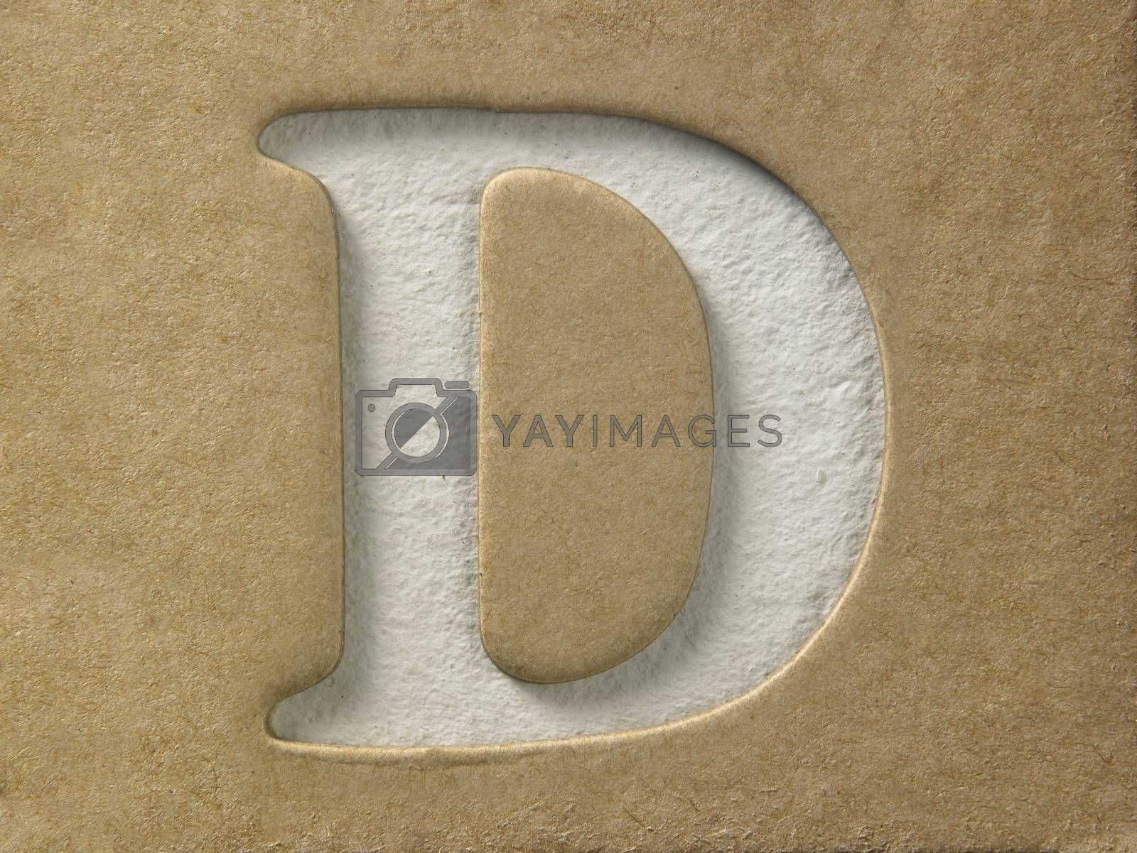 cut out alphabet d on the brown cardboard