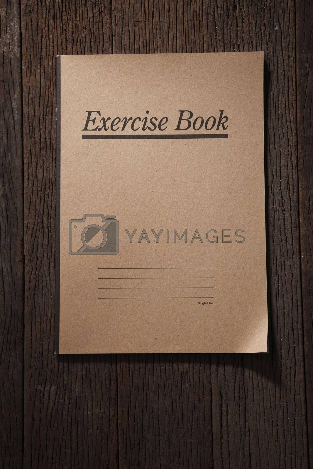 exercise book on the wooden background