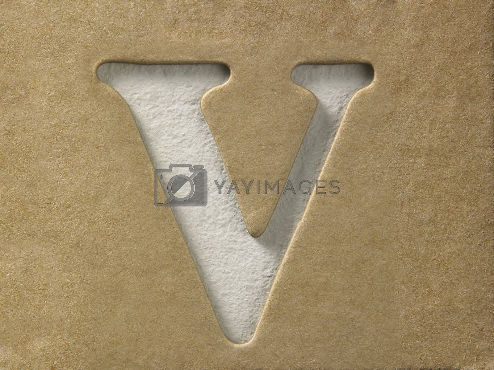 cut out alphabet v on the brown cardboard