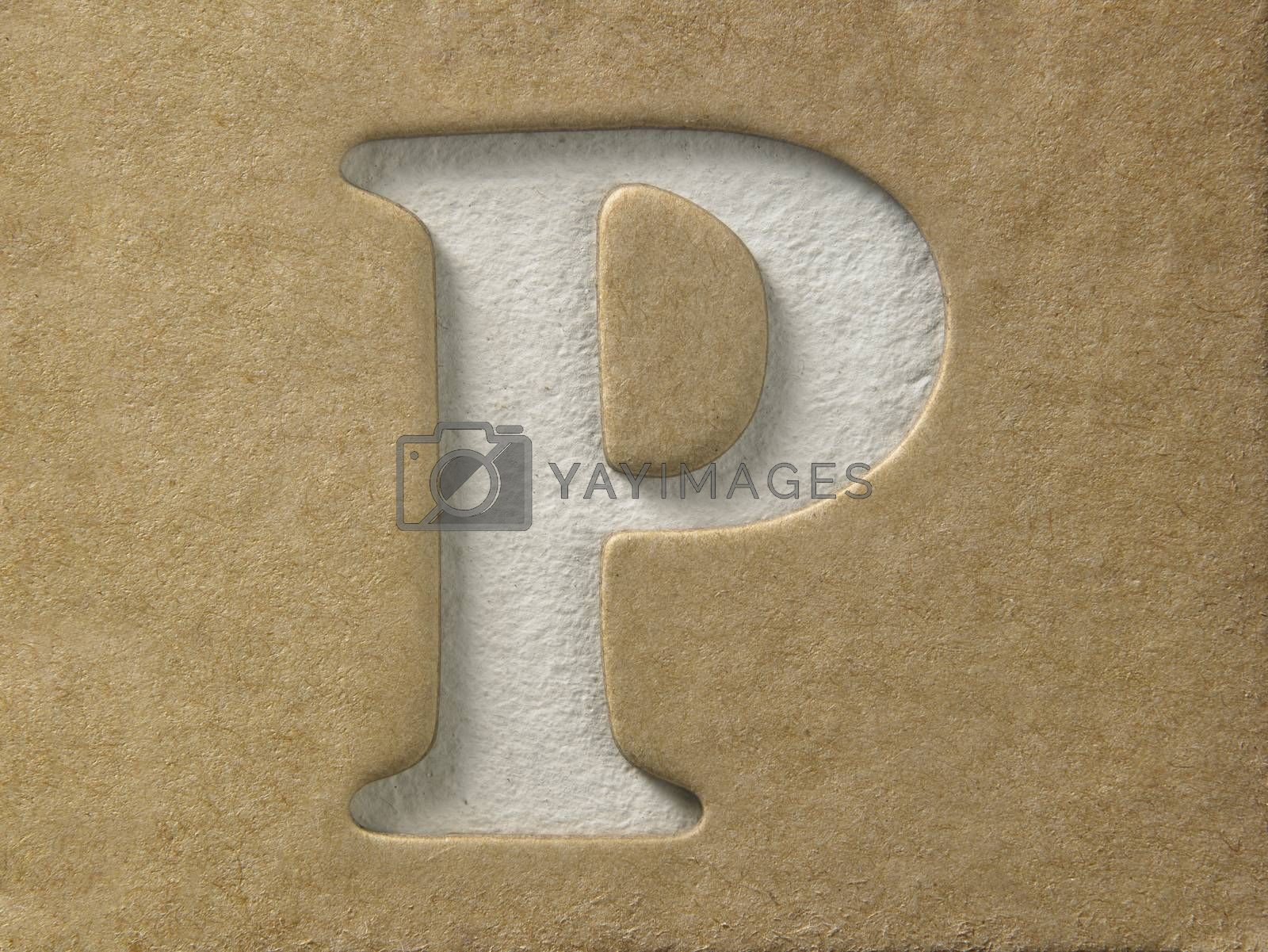 cut out alphabet p on the brown cardboard
