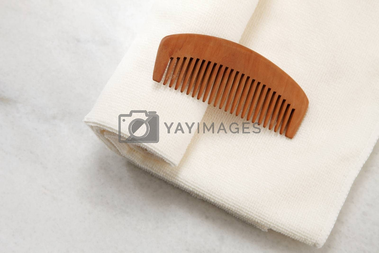 hair comb and towel on the table