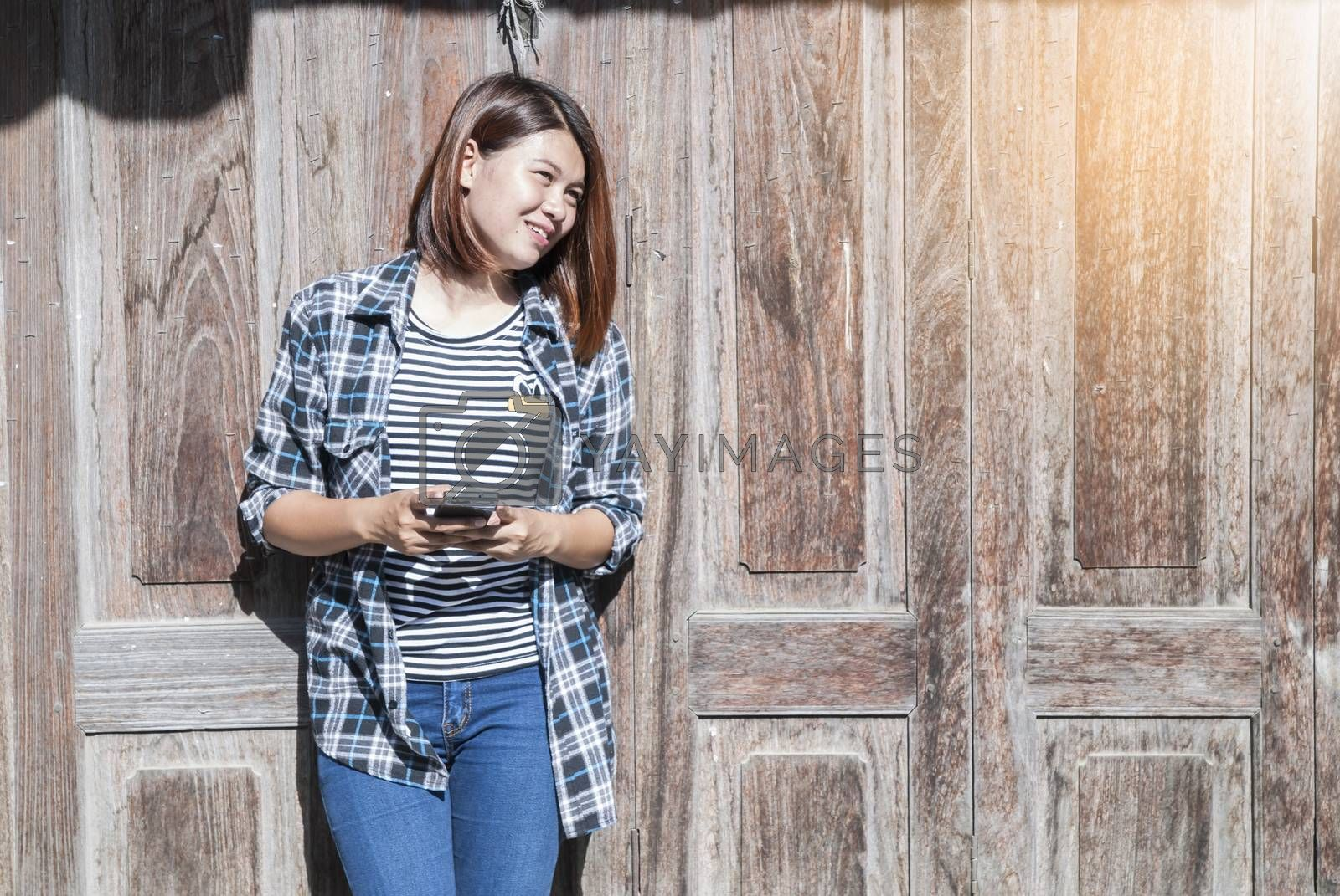 young woman happy with her phone and wooden background