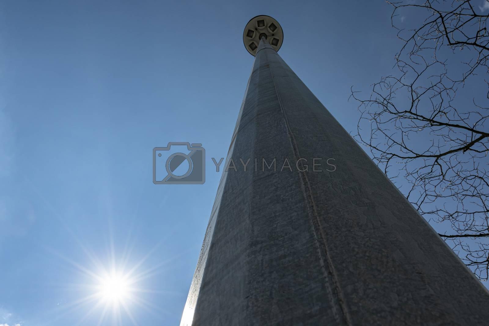 Metal pylon of street lighting seen from below