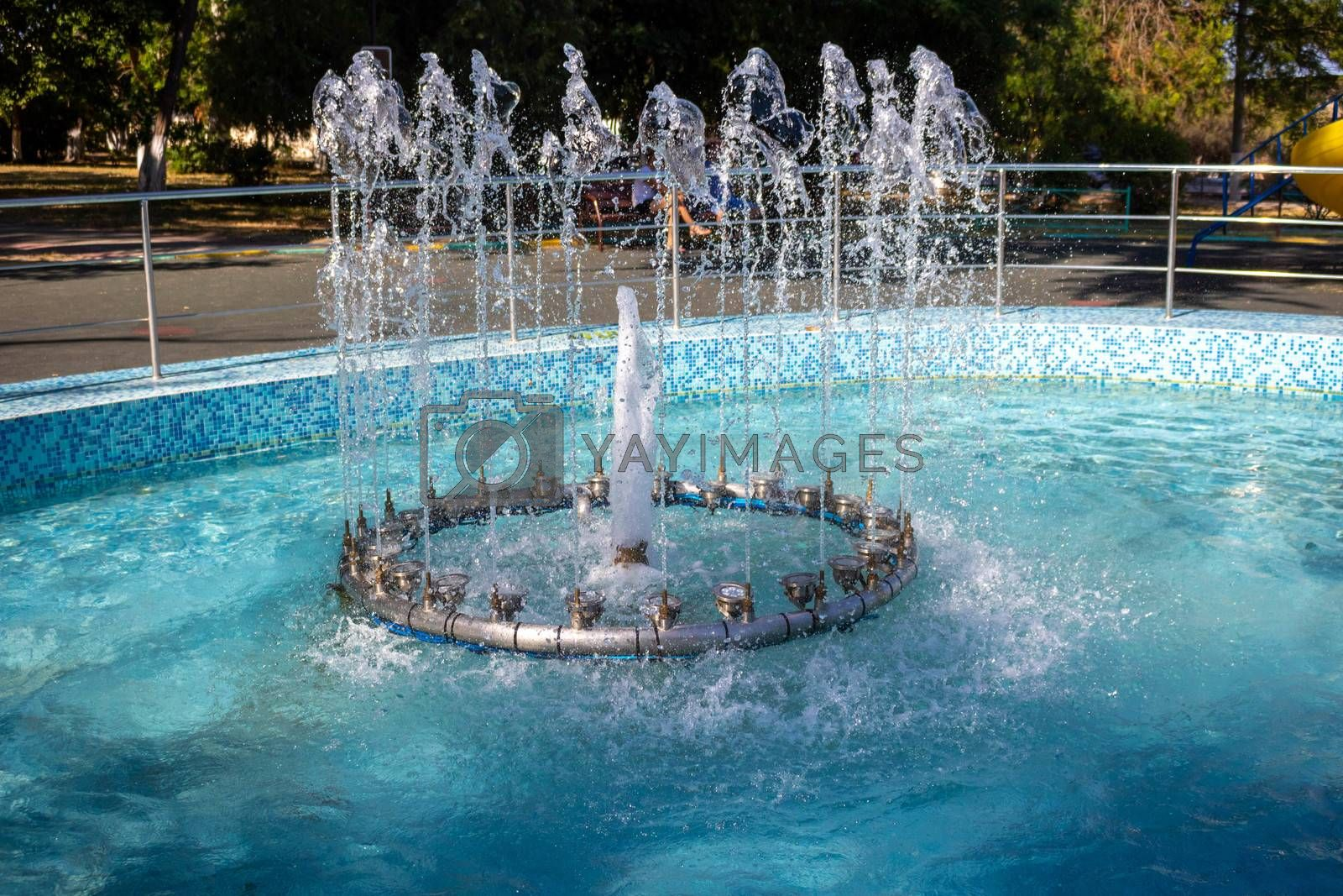 Fountain in the children's Park.Several jets spray up.Sunny day