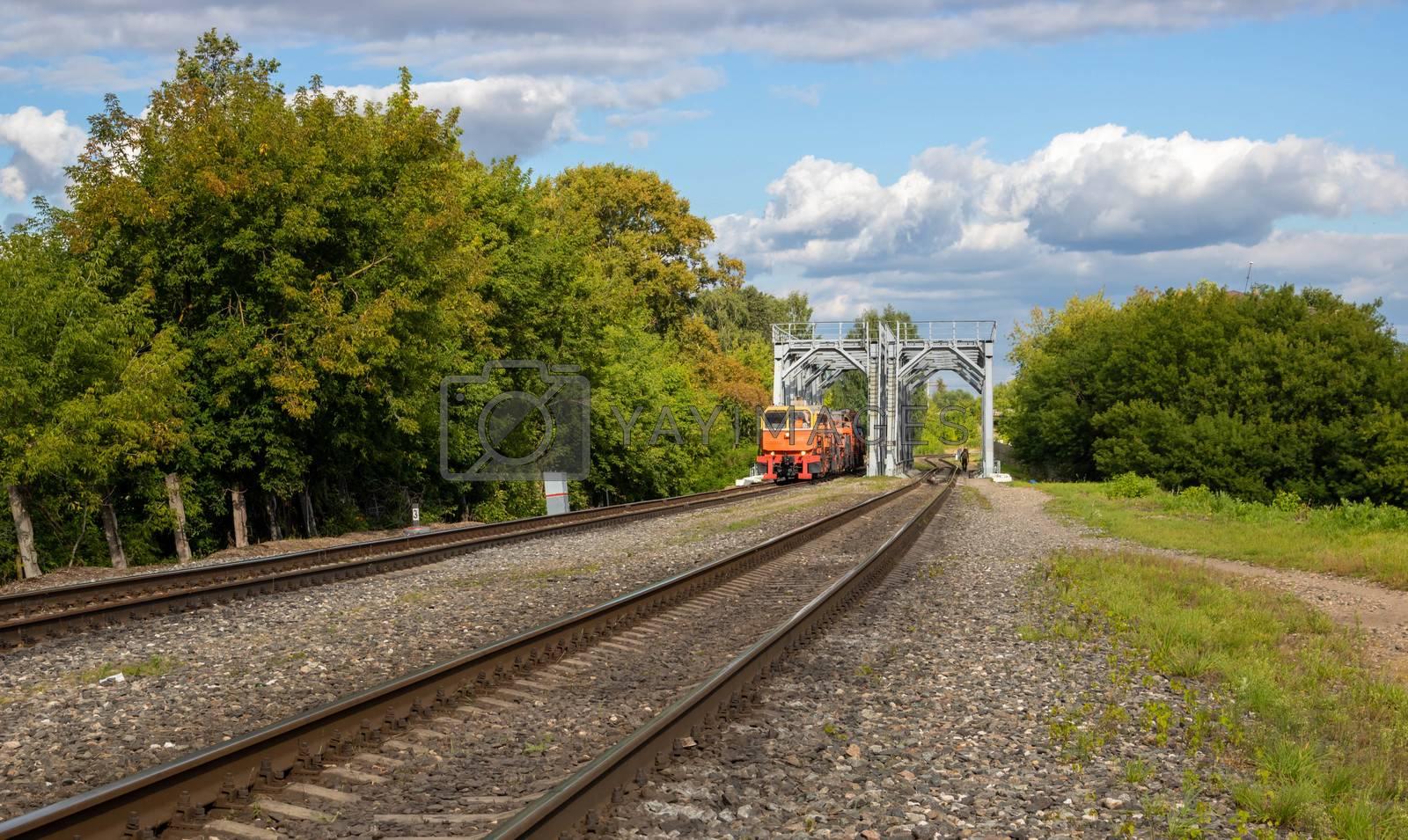 On the railway bridge is a locomotive.