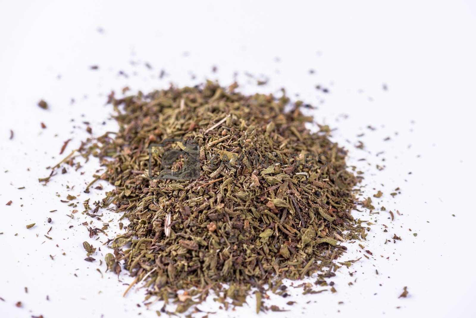 Mixed dried herbs on white background.