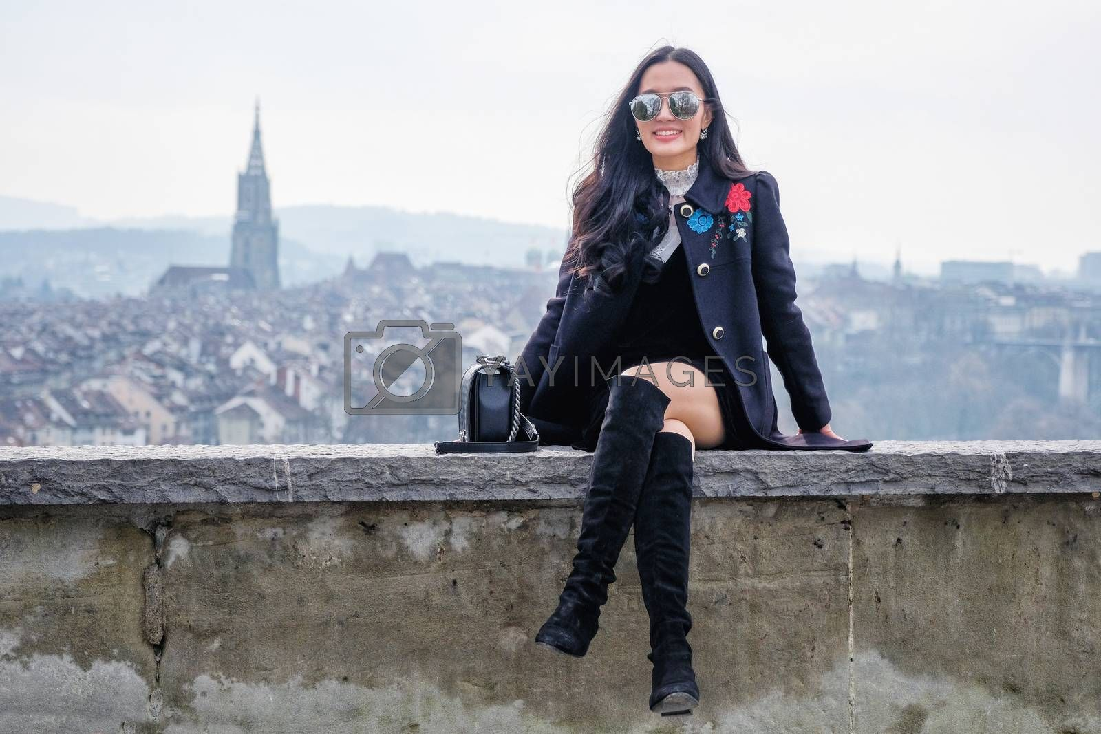 Young Beautiful Woman Tourists in view point near old town in Bern, Switzerland