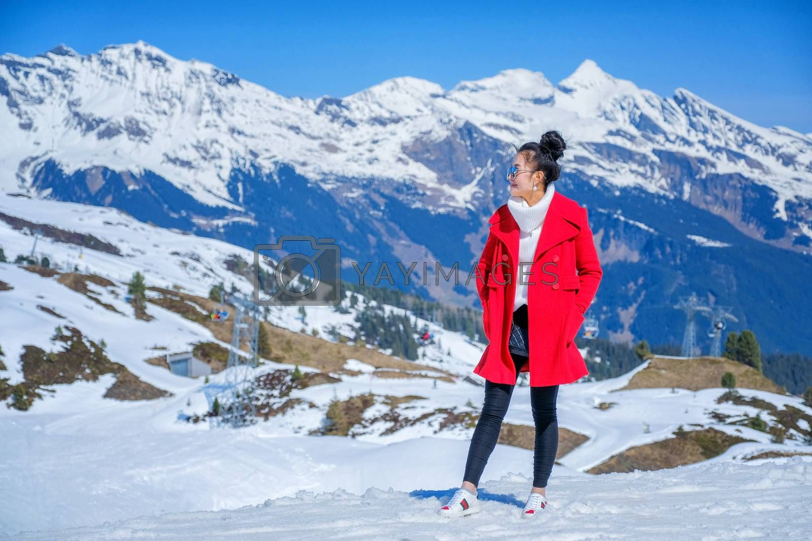 Young Woman Tourists see beautiful viewpoitn near Kleine Scheidegg station In daylight atI Switzerland