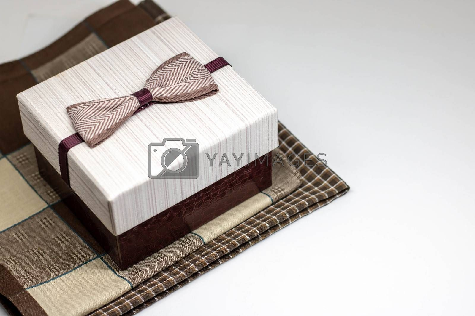 box with filling material inside. Empty natural box with decorative straw for happy gifts isolate on white background