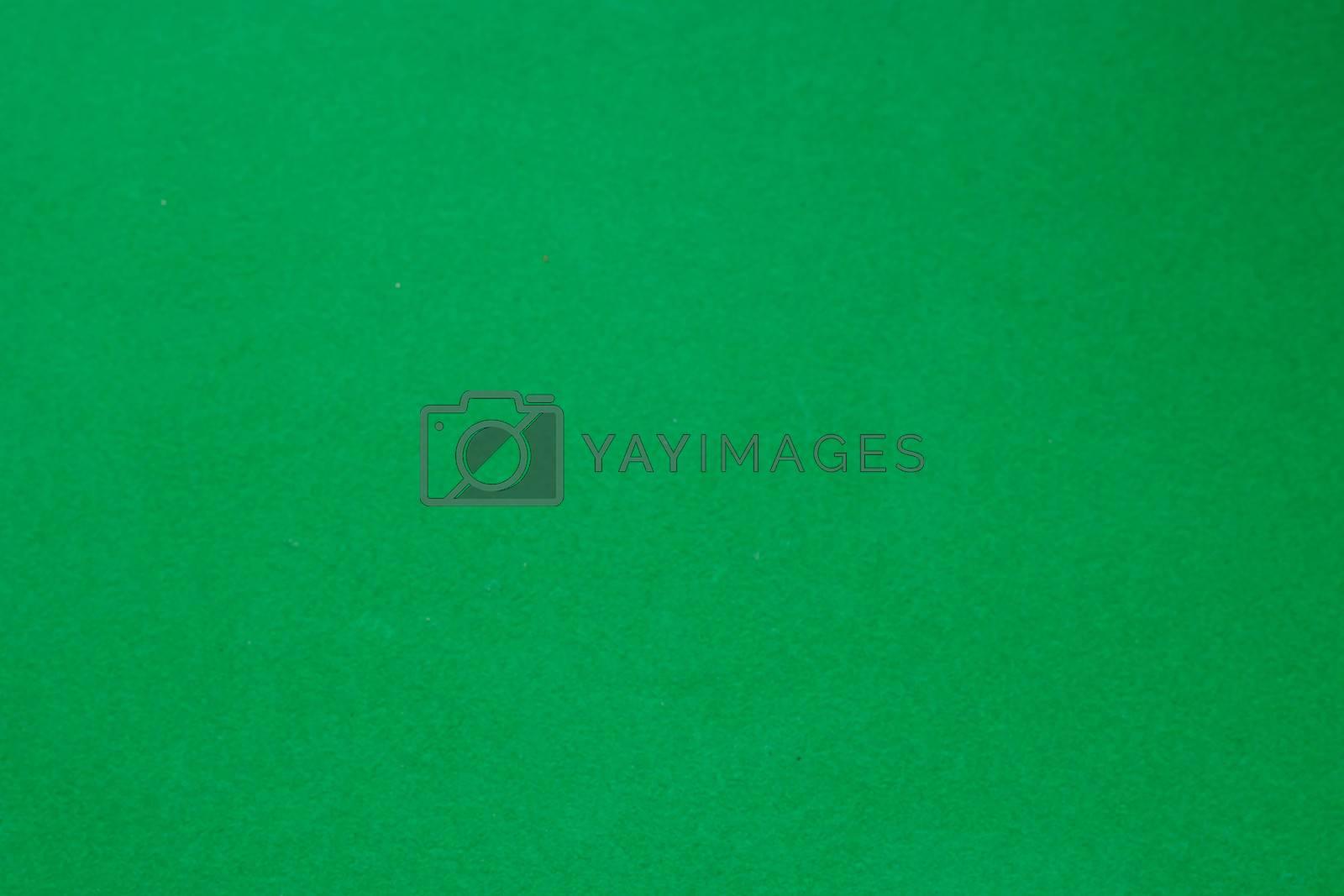 Dark green matte background of suede fabric, closeup