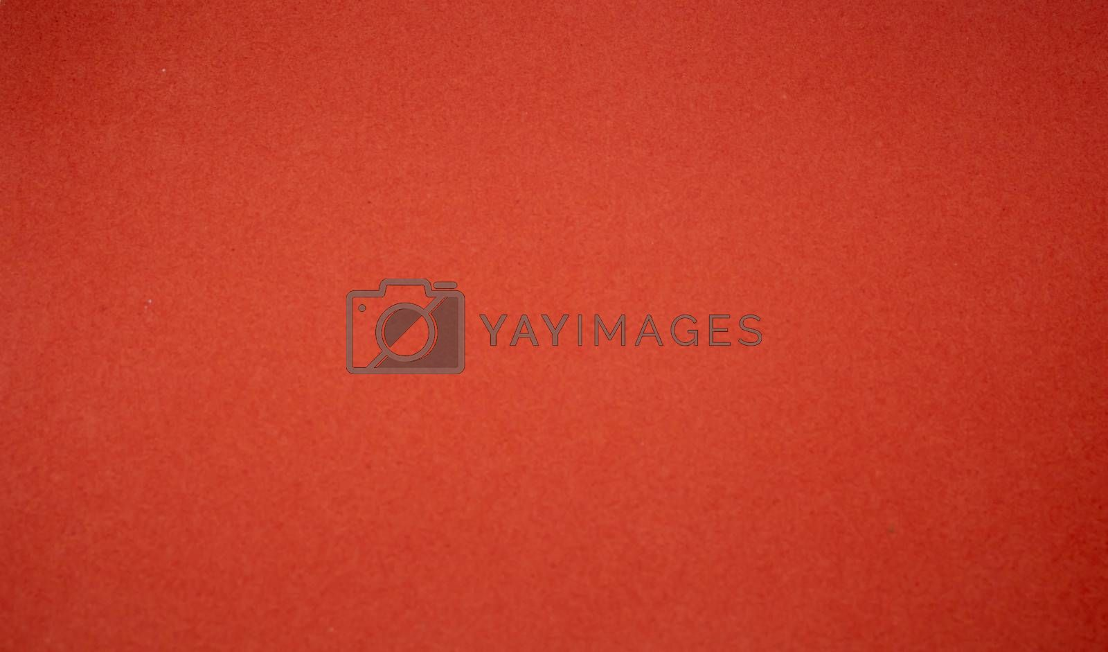Background from a red perfect suede fabric. Velvet texture