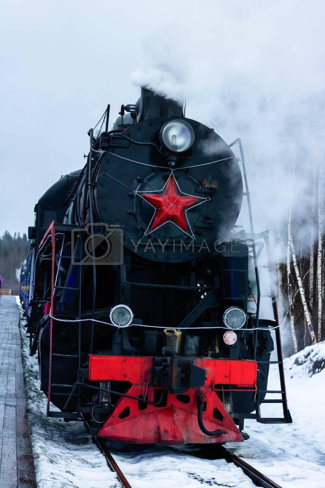 Vintage black steam locomotive train rush railway. winter