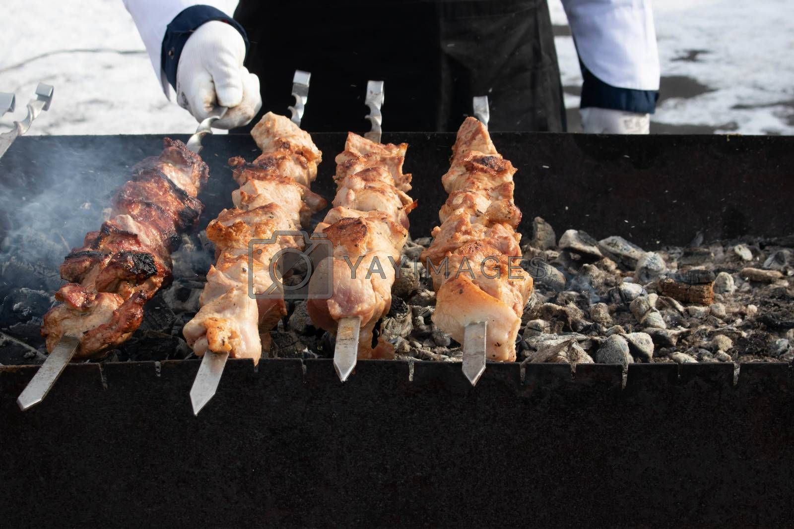 Traditional Russian shashlik on a barbecue skewer, cooking outdoor activities meat on skewers