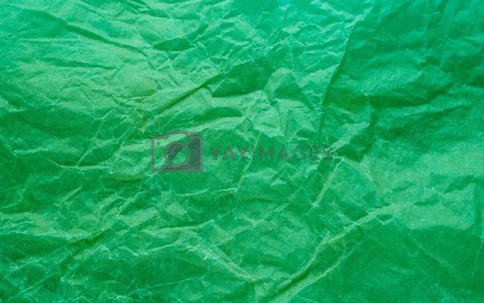 Rumpled paper texture green. Texture of crumpled paper. Crumpled paper. Wrinkles paper.