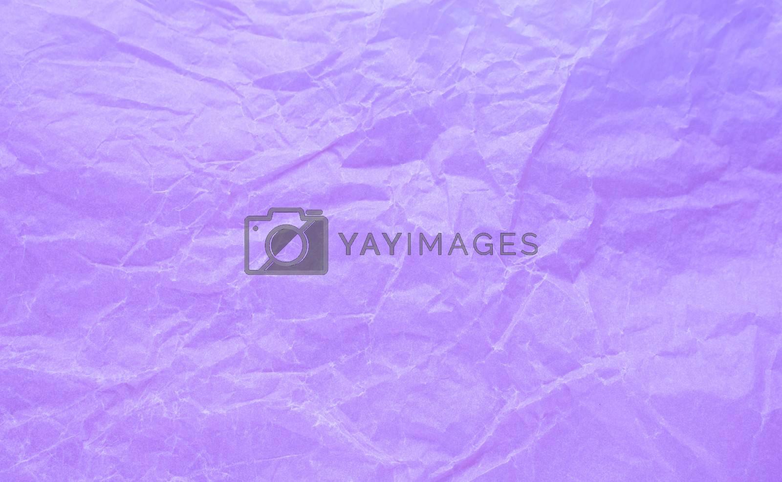 Rumpled paper texture purple. Texture of crumpled paper. Crumpled paper. Wrinkles paper