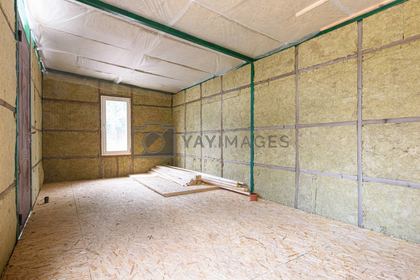 Construction of a small country house, frame insulated with mineral wool