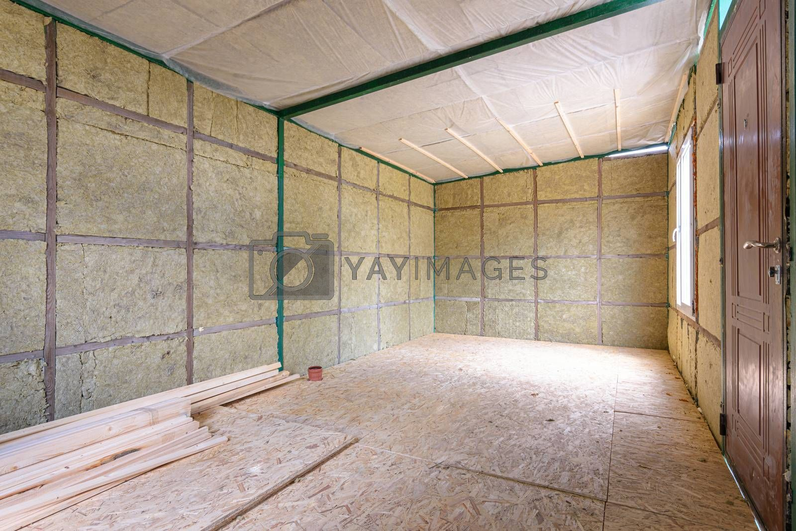 The interior of a suburban room under construction, insulated from the inside with soft thermal insulation
