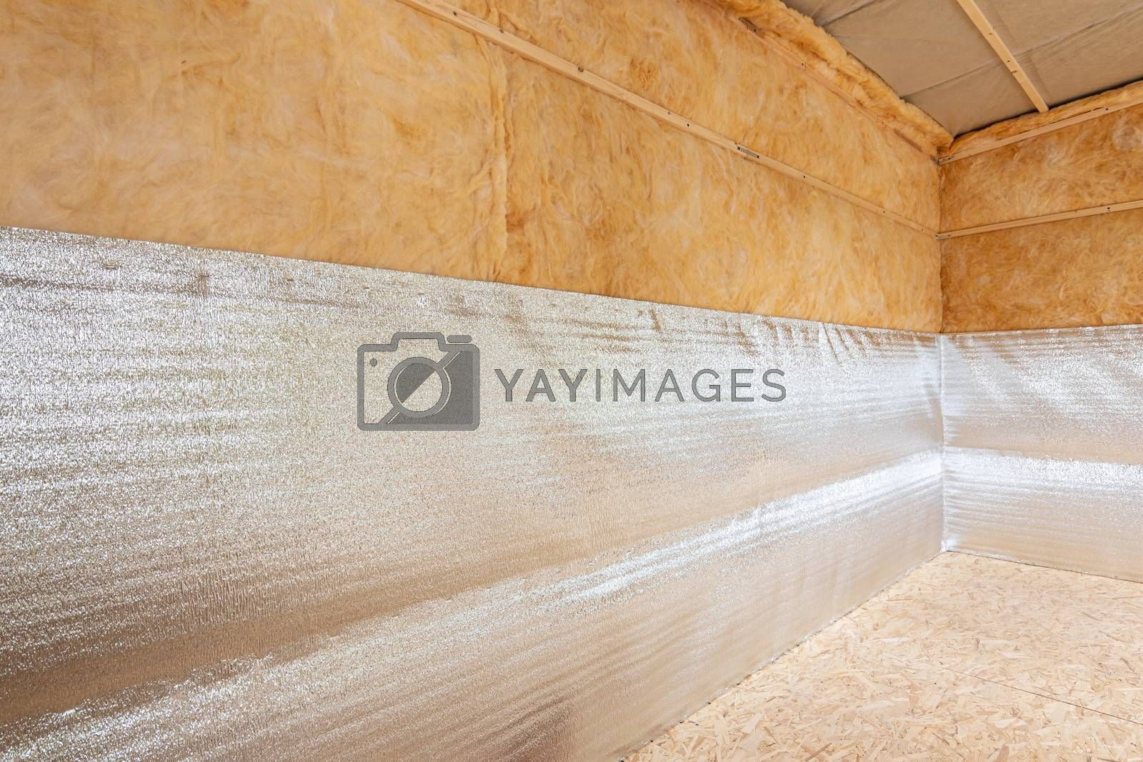 Thermal insulation of a country house from reflective foamed polyethylene laminated with lavsan for house insulation