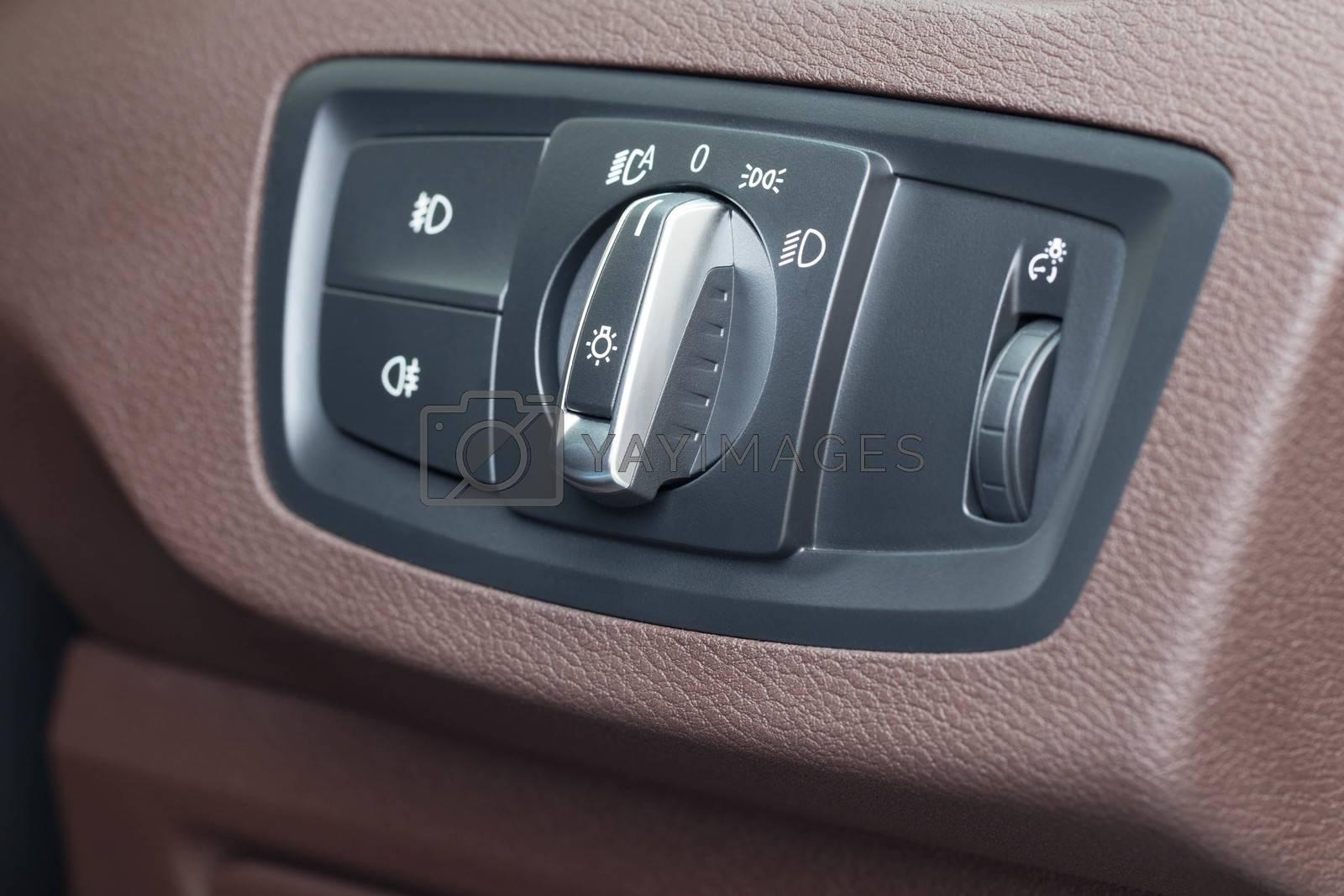 Car light switch close up