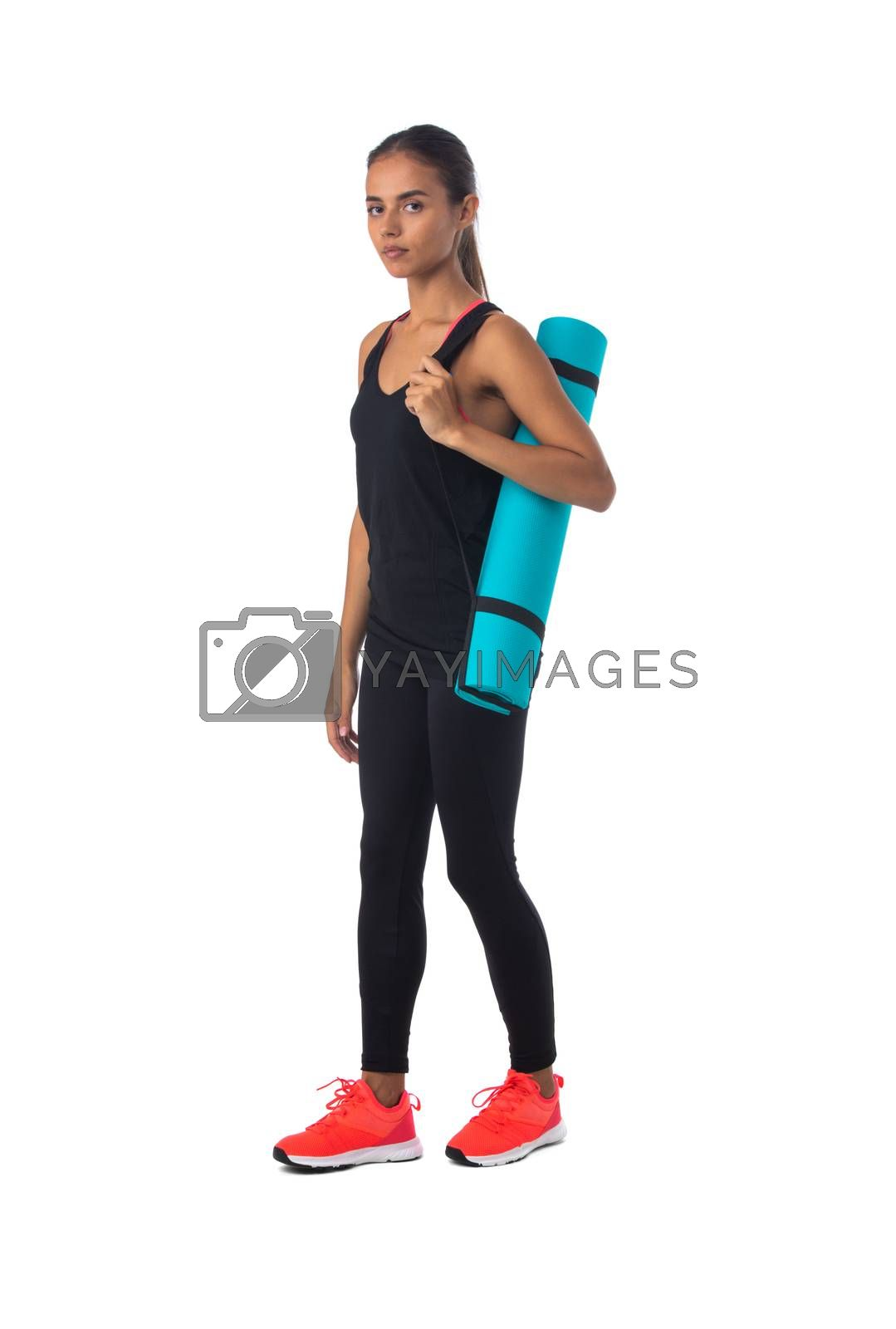 Healthy hispanic fitness girl with rolled gymnastics yoga mat isolated on white background