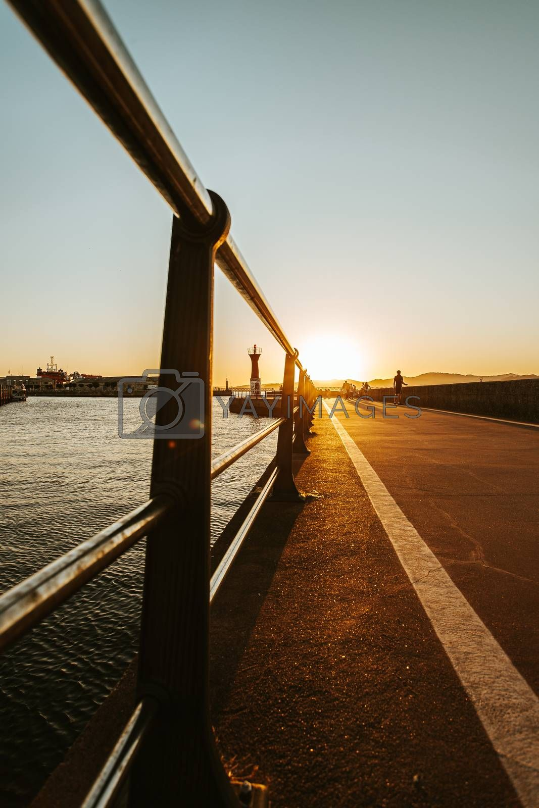 A ant view image of the path in the docks of vigo during a burning sunset