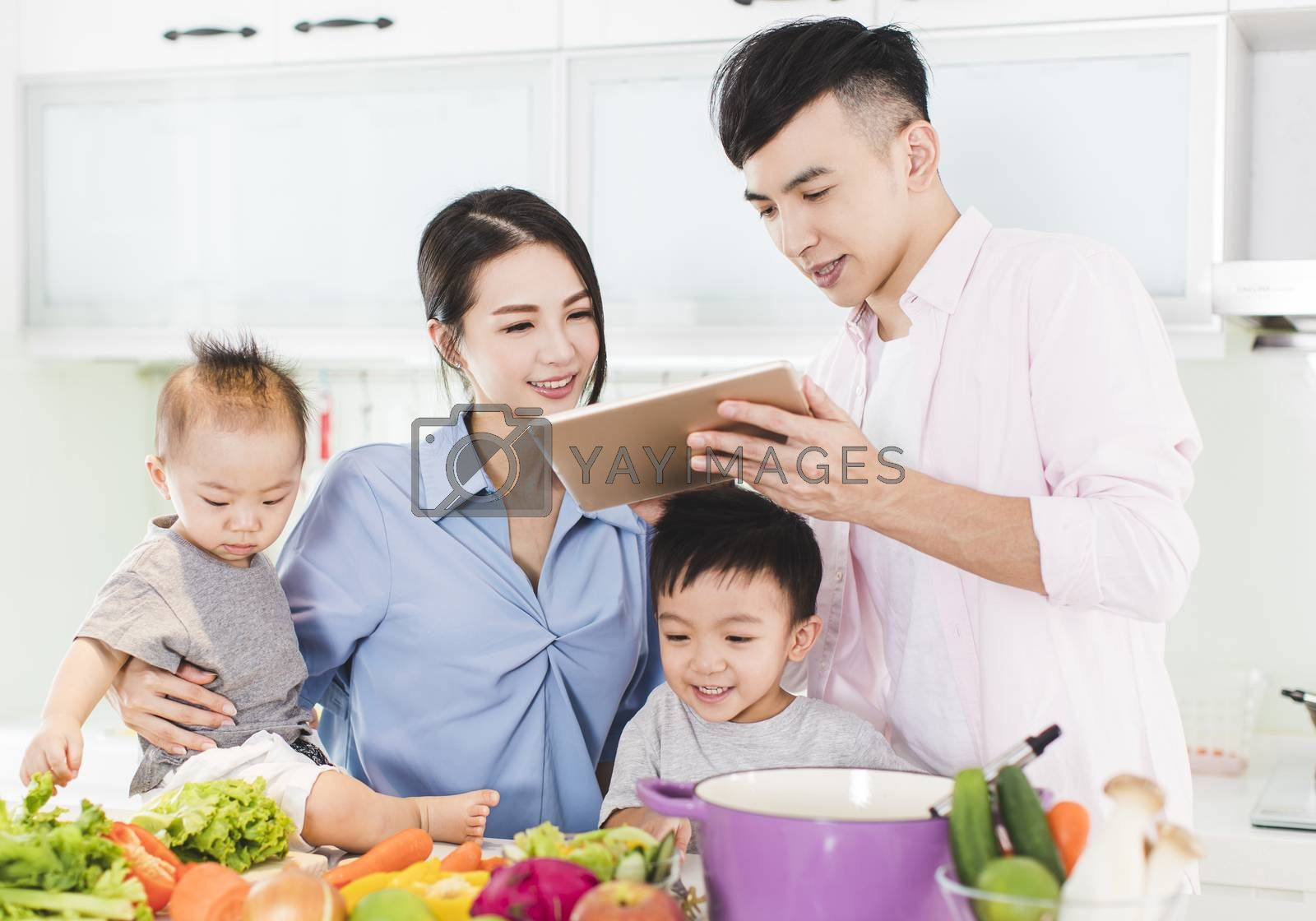 happy family preparing dinner with healthy  food in kitchen