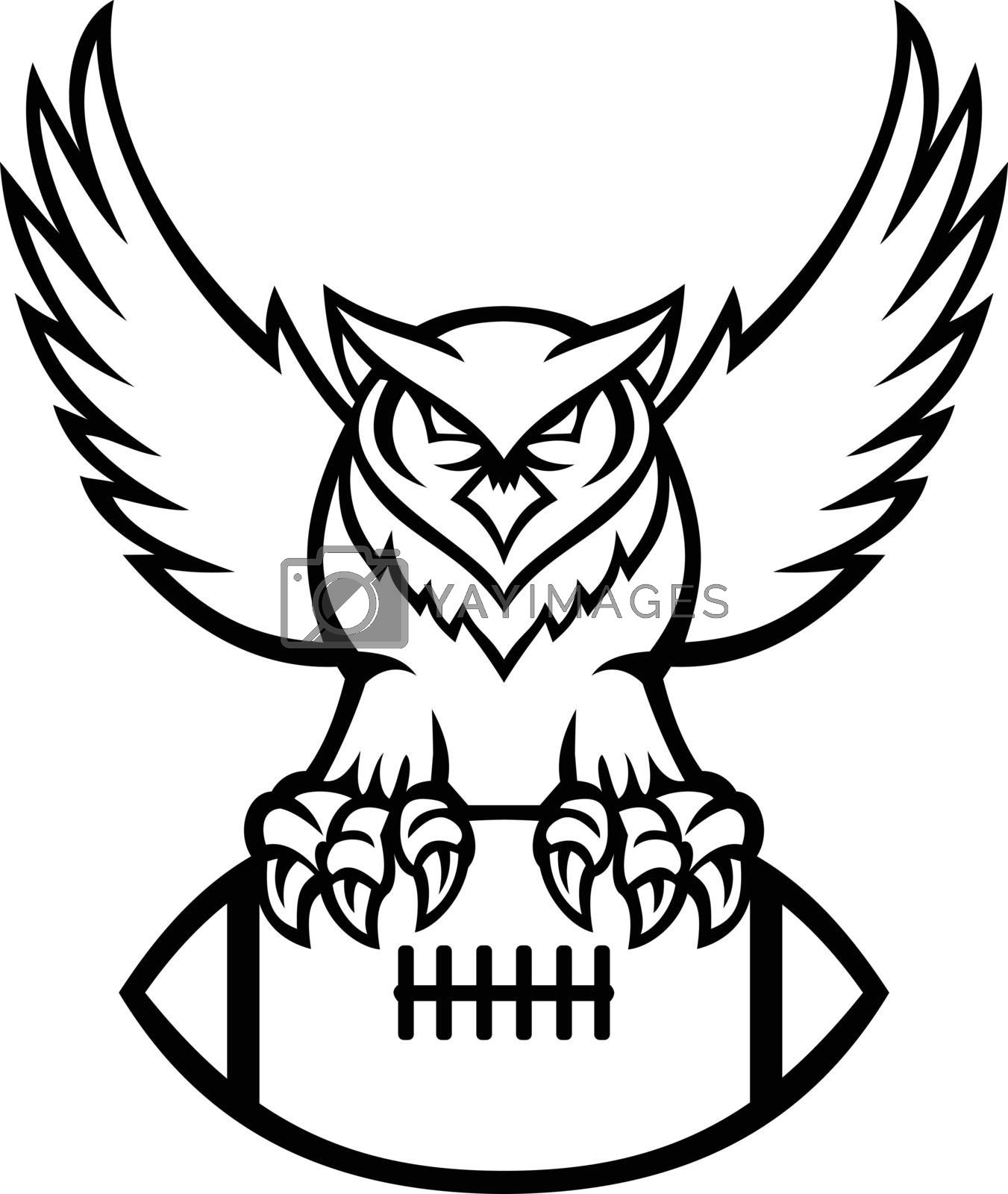Mascot illustration of a great horned owl, tiger owl or hoot owl, a large owl native to the Americas, clutching an American football ball viewed from front in retro black and white style.
