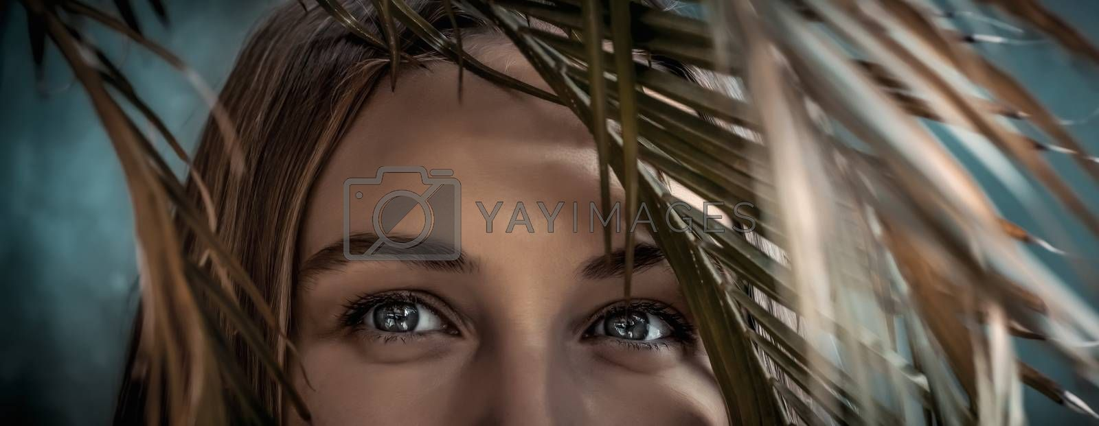 Portrait of a Beautiful Young Woman On Tropical Island In Vacation. Closeup Photo Of a Woman's Eyes Looking through Palm Leaves. Enjoying Exotic Nature.
