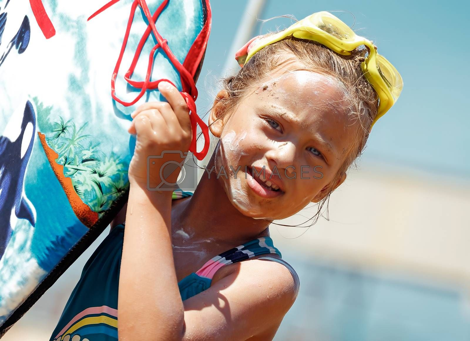 Portrait of a Nice Little Girl Wearing Goggles with Sunscreen on Face Holding Body Board. Spending Summer Vacation on the Sea. Happy Leisure Time on the Beach Resort. Healthy Sportive Childhood.