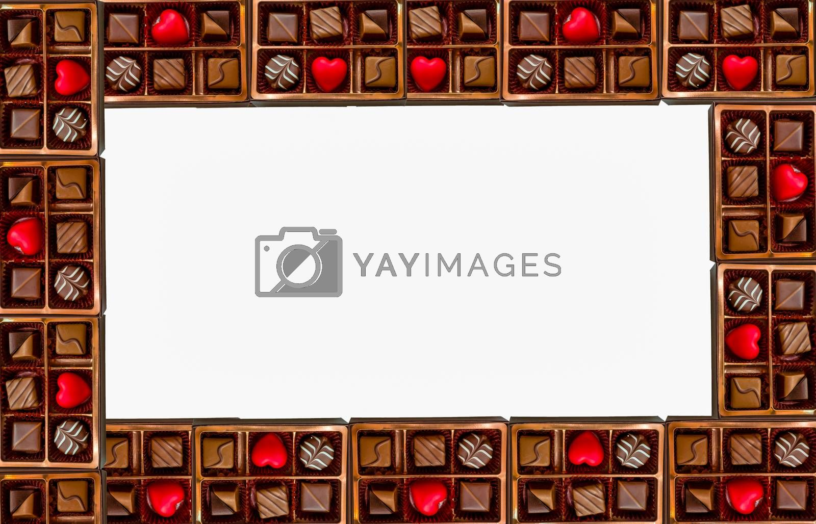 Frame of assorted chocolates with red heart chocolate