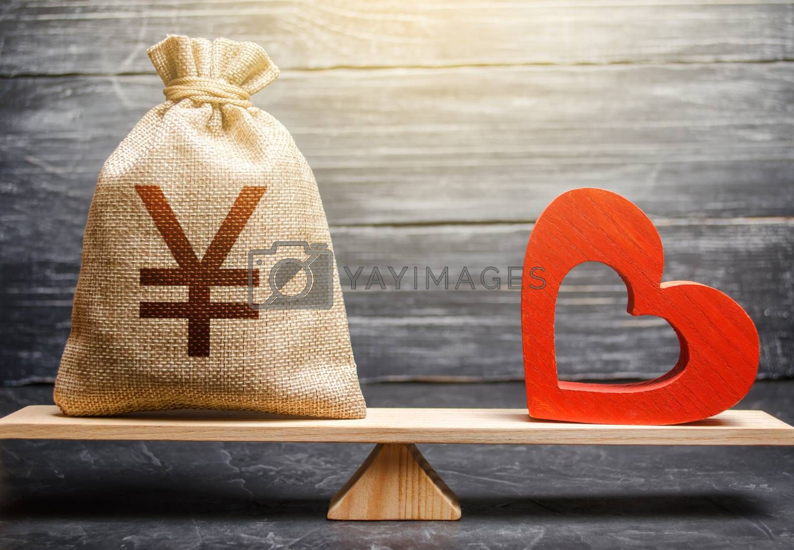 Yen Yuan money bag and red heart on scales. Health life insurance financing concept. Subsidies. Reforming and preparing for new challenges. Support and life quality improvement. Funding healthcare.