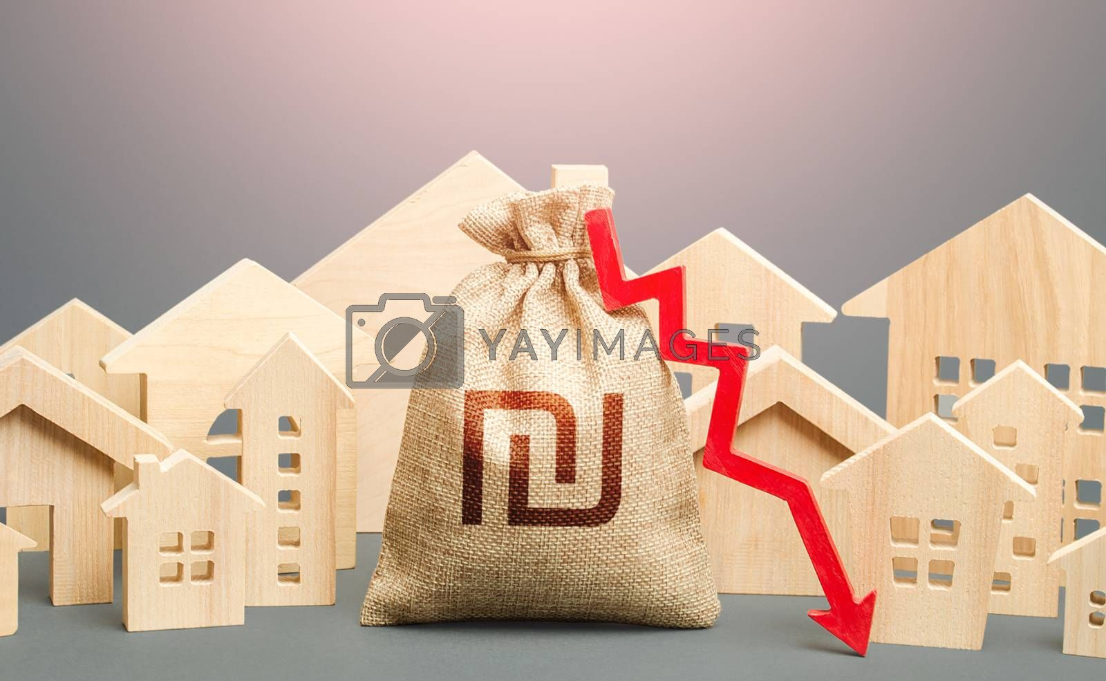 City residential buildings and israeli shekel money bag with a red down arrow. Lower mortgage interest rates. Low demand for home buying. Low cost real estate. Falling prices for rental apartments.