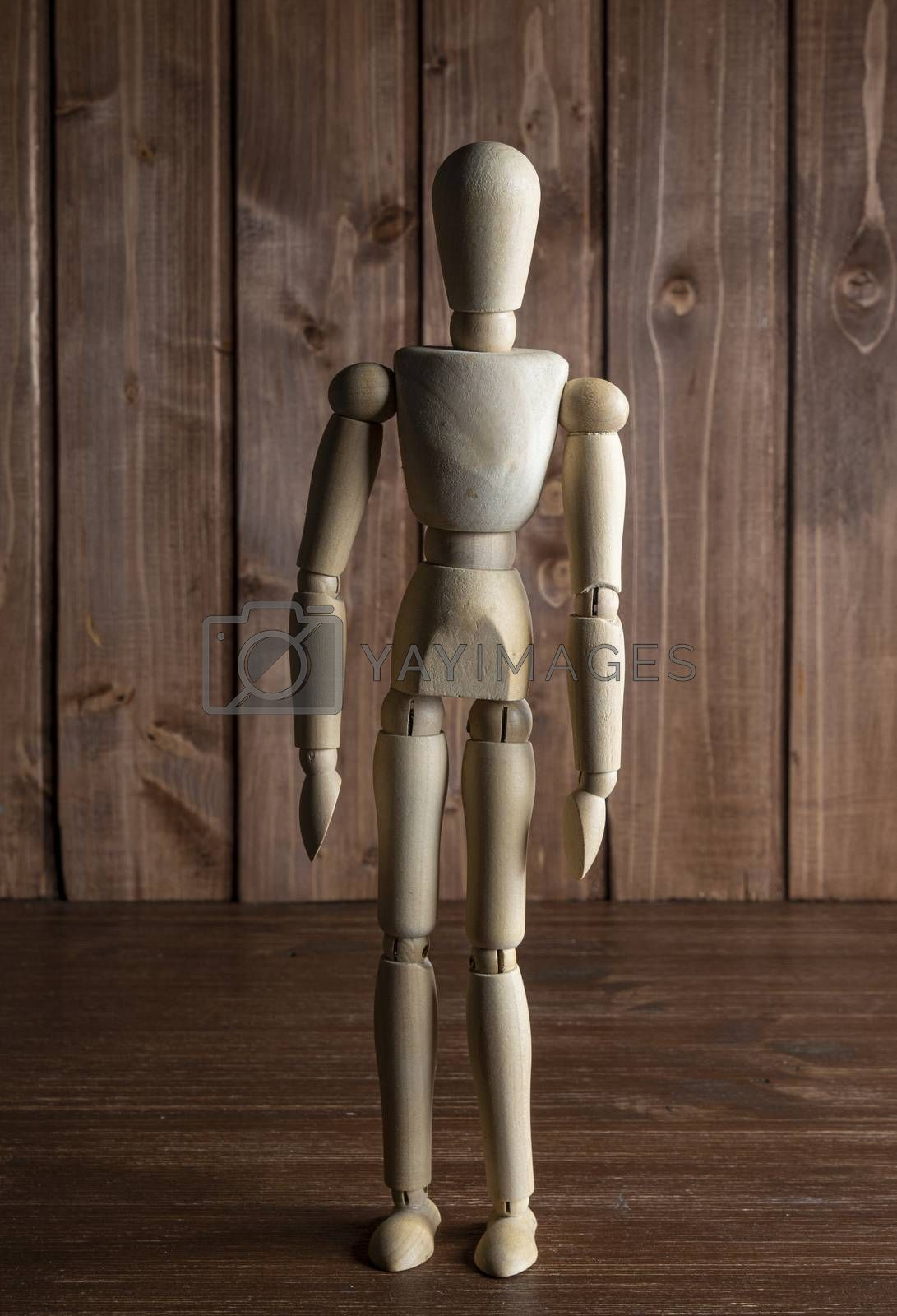 A mannequin on a wooden surface