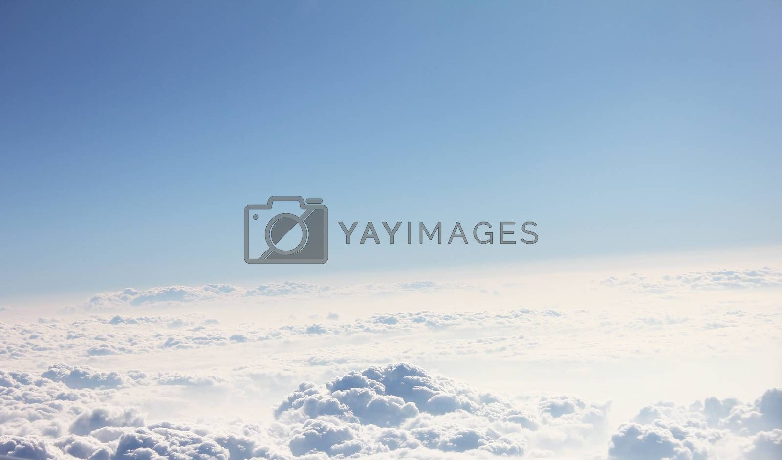 Blue sky and clouds. Plane view above the earth, can be used for background
