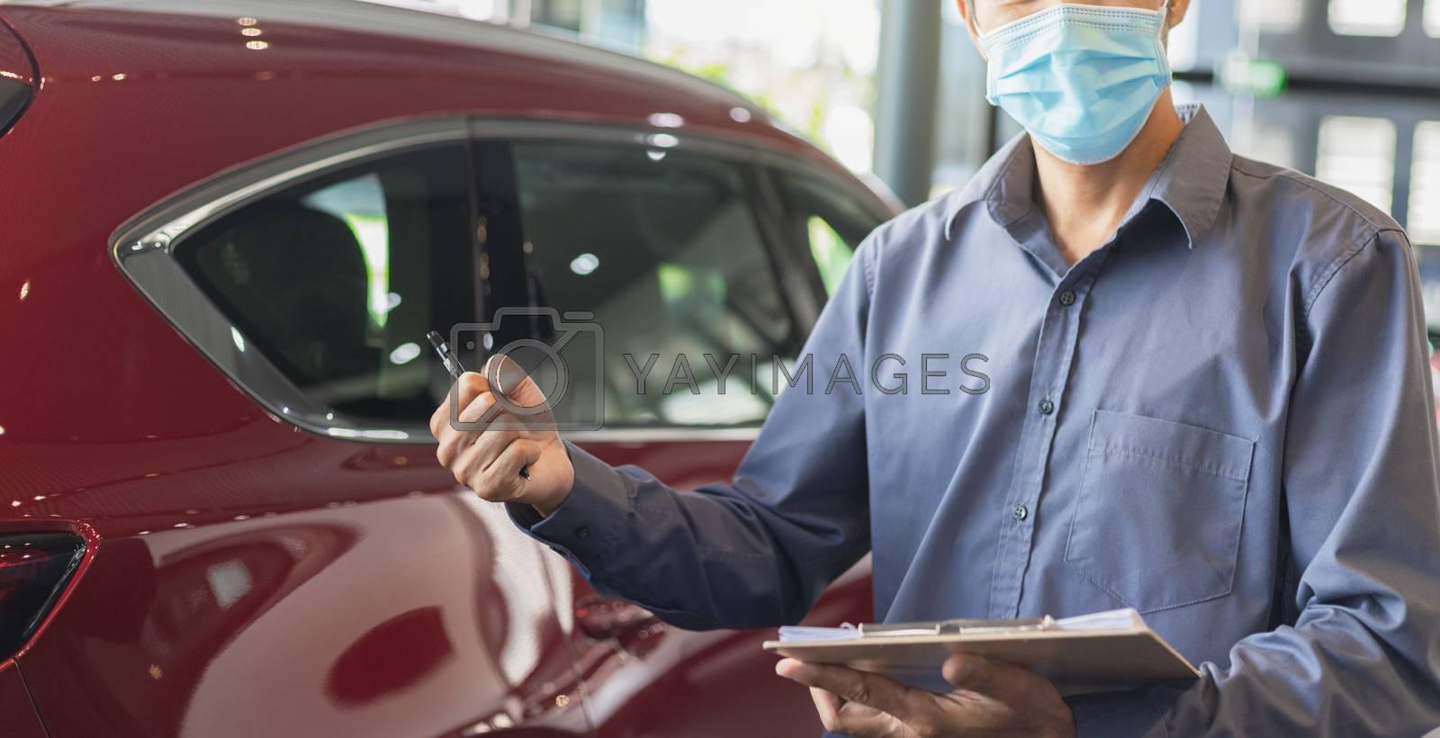 Asian saleman wear surgical mask working in inspector checking w by oatzpenzstudio