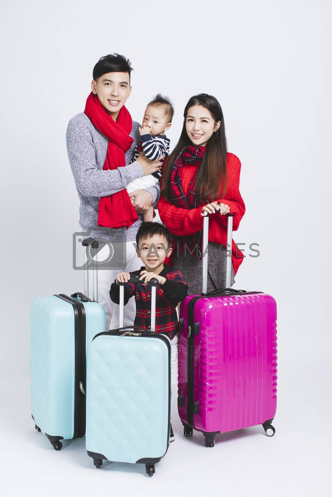 happy family wearing warm clothes on white background. and Winter vacation concepts